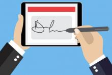 Graphic showing user signing digitally on tablet